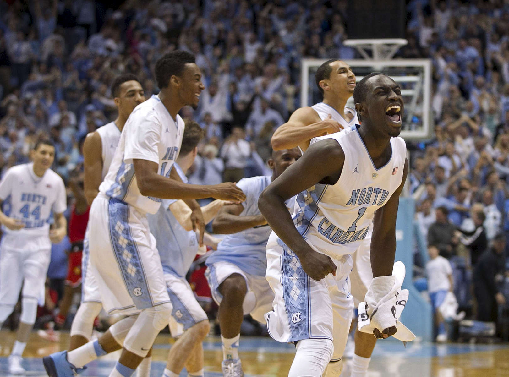 Second Place | SportsRobert Willett, News & Observer UNC's Theo Pinson (1) celebrates the Tar Heels' 72-71 victory with his teammates on Saturday, January 10, 2015 at the Smith Center in Chapel Hill, N.C.