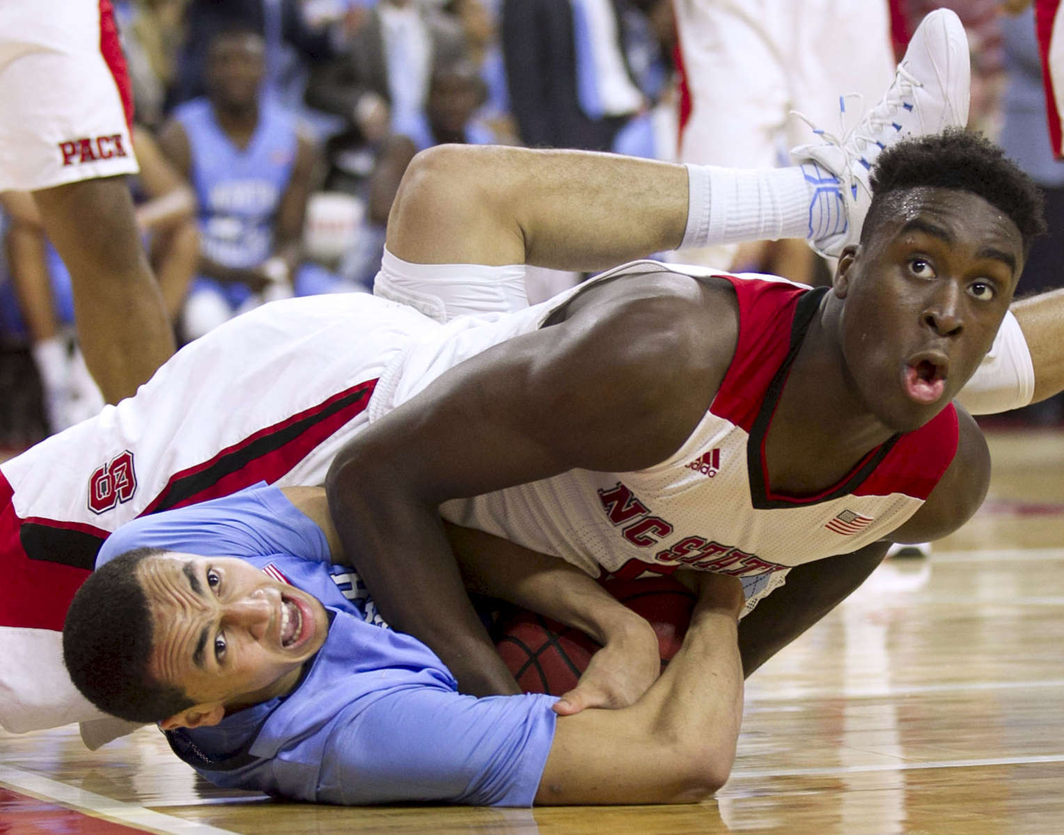 Honorable Mention I SportsRobert Willett, News & Observer UNC's Marcus Paige (5) and N.C. State's Abdul-Malik Abu (0) get tangled during a battle for a loose ball during the second half on Wednesday, January 14, 2014 at the PNC Arena in Raleigh, N.C.