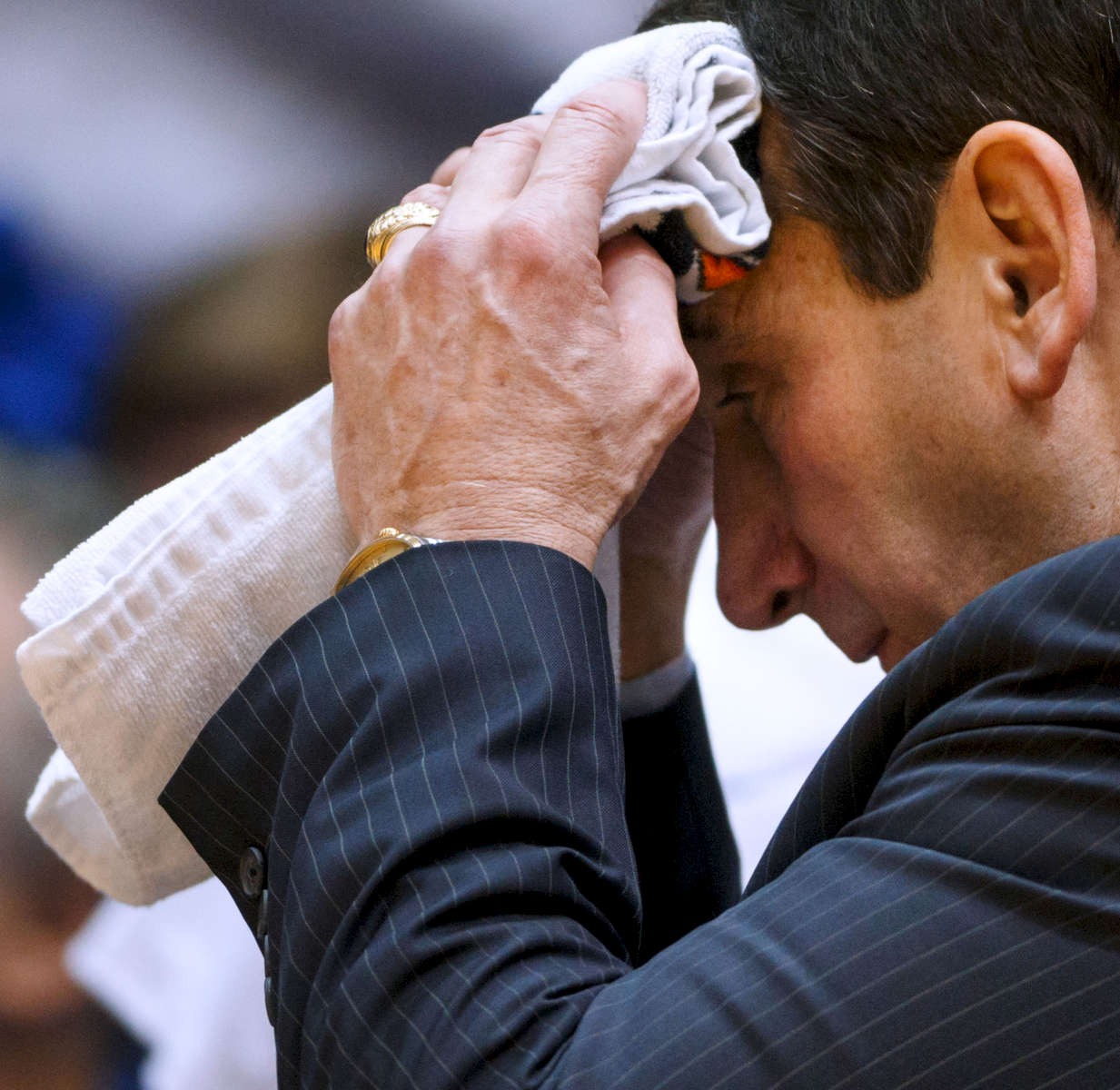 Second Place | Multiple PhotosJerry Wolford, News & RecordDuke head coach Mike Krzyzewski  wipes his brow with a towel as the game heats up. ACC Basketball action with Pittsburgh at Duke  in Cameron Indoor Stadium on Monday, January 19, 2015, in Durham, N.C.