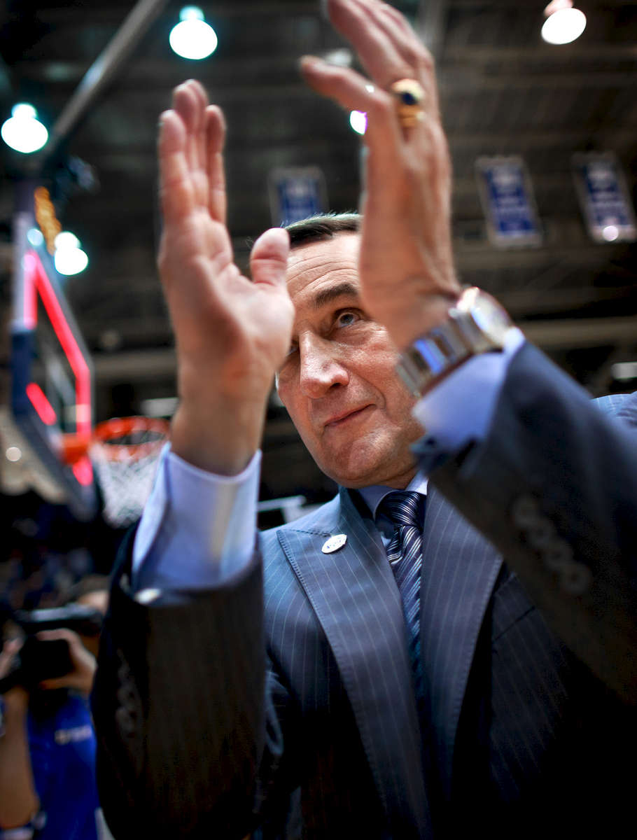 Second Place | Multiple PhotosJerry Wolford, News & RecordHead coach Mike Krzyzewski applauds Duke fans as he leaves the Cameron Indoor Stadium court following the Blue Devils 79-65 victory over Pittsburgh – the 999th win of his career. The Hall-of-Fame  coach claimed his 1,000th victory at Madison Square Garden against St. John\'s on Jan. 25, 2015. He is the first NCAA Division I men\'s coach to reach the milestone. Krzyzewski has led the Blue Devils to four NCAA Championships in 31 years.