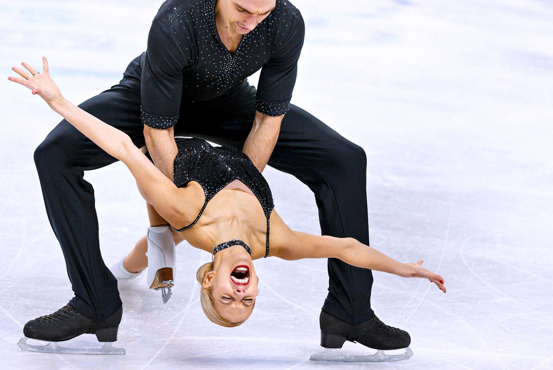 Third Place | Multiple PhotosJerry Wolford, News & RecordAlexa Scimeca and partner Chris Knierim perform in the Championship Pairs short program at the U.S. Figure Skating Championships, Tuesday, January 22, 2015, at the Greensboro Coliseum.
