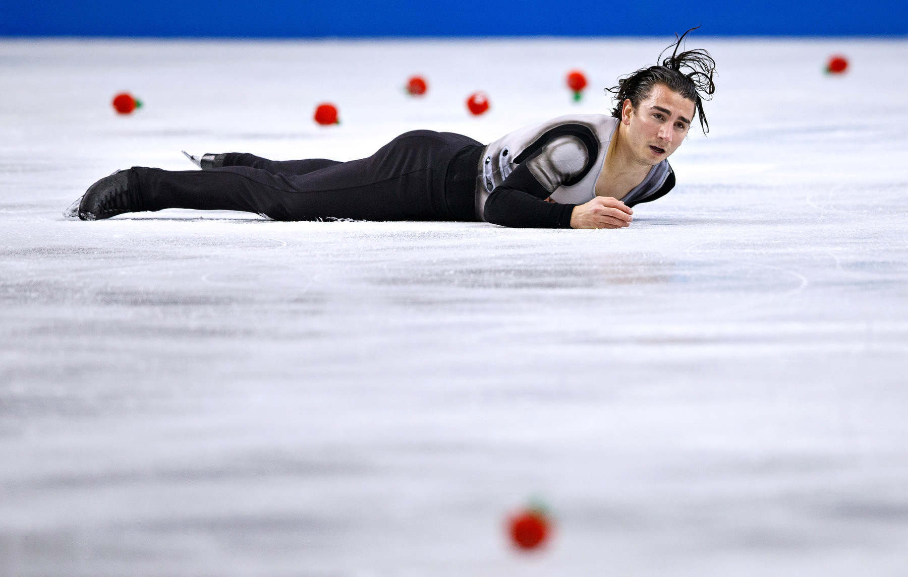 Third Place | Multiple PhotosJerry Wolford, News & RecordMax Aaron ends his performance by sliding across the ice in the Men\'s Free Skate during the U.S. Figure Skating Championships, Sunday, January 25, 2015, at the Greensboro Coliseum.