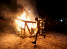 Third Place | Spot NewsAl Drago, Elon UniversityA shirtless Duke fan runs around a bonfire following Duke\'s 92-90 overtime win over North Carolina on February 20, 2015.