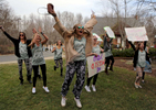 Honorable Mention I General NewsAl Drago, Elon UniversityMembers of Zeta Tau Alpha scream as their new sisters run down the hill to the ZTA house on sorority bid day at Elon University on February 2, 2015.