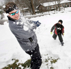 Honorable Mention I FeatureMark Dolejs, Daily DispatchTracy Greenway gets smacked in the face with a snowball by his son Grayson at their Woodland Road home Thursday afternoon.
