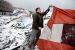 Honorable Mention I Multiple PhotosMark Dolejs, Daily DispatchDuke senior E.J. Baldridge fixes one of the poles on his tent before the Duke Blue Devils take on the North Carolina Tar Heels in their game at Cameron Indoor Stadium. Heavy snow a couple of hours before game time collapsed some of the tents in Krzyzewskiville where students were camped out for game tickets.