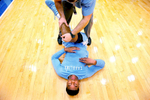 Honorable Mention I Multiple PhotosMark Dolejs, Daily DispatchNorth Carolina\'s Isaiah Hicks stretches before the start of their game at Duke.