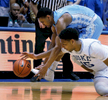 Honorable Mention I Multiple PhotosMark Dolejs, Daily DispatchNorth Carolina\'s Joel Berry II (2) and Duke\'s Jahlil Okafor (15) scramble for the ball in their game at Cameron Indoor Stadium.