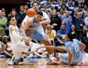 Honorable Mention I Multiple PhotosMark Dolejs, Daily DispatchNorth Carolina\'s Kennedy Meeks (3) gets tangled up with Duke\'s Tyus Jones (5) and Jahlil Okafor (15) as they go for a loose ball near the end of regulation play.
