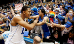 Honorable Mention I Multiple PhotosMark Dolejs, Daily DispatchDuke\'s Matt Jones (13) greets fans after they beat the North Carolina Tar Heels 92-90 in overtime at Cameron Indoor Stadium.