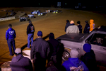 Second Place | Multiple PhotosAndrew Craft, The Fayetteville ObserverSpectators watch a race as they wait to cross the track into the pit area Saturday, March 28, 2015, at Fayetteville Motor Speedway in Fayetteville, N.C.
