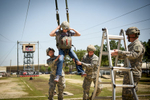 Second Place | FeatureAndrew Craft, The Fayetteville ObserverSoldiers pull NASCAR Sprint Cup driver Kasey Kahne towards a ladder so they can unhook him from his harness Thursday, April 23, 2015, after sliding down a wire from a jump tower on Fort Bragg.