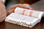 Elder Stock underlines passages that encourage him in his copy of the Book of Mormon.