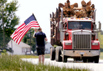 Second Place | FeatureMark Dolejs, Daily DispatchEric Ellis walks along U.S. 158 from Middleburg toward Henderson as he walks to bring recognition to fallen military service members and first responders. The 2,000-mile walk, called Carry The Load, consists of several people who walk two-hour shifts for approximately five miles.