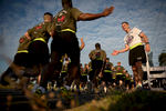 Third Place | FeatureAndrew Craft, The Fayetteville ObserverMaj. Gen. Richard D. Clarke, right, high fives 82nd Airborne Division paratroopers during the division run Monday, May 18, 2015, on Fort Bragg, N.C.