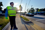 Second Place | Multiple PhotosMykal McEldowney, The Greenville NewsFelissa plans on staying at East North Street. She's one of 75 civilian employees of the Greenville County Sheriff's Office who work part-time covering 38 schools as crossing guards. {quote}Have a blessed day,{quote} Latimore wishes every driver and walker that passes.