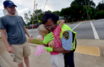 Second Place | Multiple PhotosMykal McEldowney, The Greenville NewsFelissa gives a hug to Jaylen Emerson, 8, after Emerson and Harmonie and Jason Skipper presented Latimore a card on Tuesday, May 26, 2015. The card was signed by members of the Issaqueena Park neighborhood thanking Latimore for her joyful services.