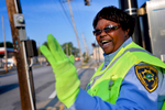 Second Place | Multiple PhotosMykal McEldowney, The Greenville NewsShe plans on smiling and waving for years to come. She's always been friendly; it's her nature. Working as a crossing guard just gives her a more visible platform.