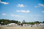 Third Place | Multiple PhotosSara Corce, The PilotJohn Schaaf rides away from arena C on Ferrante Cf during the Dressage in the Sandhills Horse Show at the Pinehurst Harness Track on Friday, May 8, 2015 in Pinehurst, North Carolina.