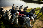 First Place | Multiple PhotosAndrew Craft, The Fayetteville ObserverSoldiers, from the 261st Multifunctional Medical Battalion, carry a zodiac out of the water as they compete in the Spearhead Medic Challenge Thursday, June 18, 2015, on Fort Bragg.