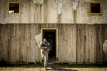 First Place | Multiple PhotosAndrew Craft, The Fayetteville ObserverA soldier, from the 261st Multifunctional Medical Battalion, runs out of a building with a paintball gun in hand during the Spearhead Medic Challenge Thursday, June 18, 2015, on Fort Bragg.