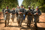 First Place | Multiple PhotosAndrew Craft, The Fayetteville ObserverSoldiers, from the 261st Multifunctional Medical Battalion, carry heavy objects sown the road as a team during Spearhead Medic Challenge Thursday, June 18, 2015, on Fort Bragg.