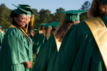 Second Place | Multiple PhotosSara Corce, The PilotTianna Lane (left) smiles at her fellow graduates as they walk to their seats on the football field during high school graduation at Pinecrest High School on Saturday, June 13, 2015 in Southern Pines, North Carolina.