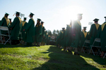 Second Place | Multiple PhotosSara Corce, The PilotGraduates file to their seats on the football field during high school graduation at Pinecrest High School on Saturday, June 13, 2015 in Southern Pines, North Carolina.