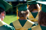 Second Place | Multiple PhotosSara Corce, The PilotGraduates sit in their seats on the football field during high school graduation at Pinecrest High School on Saturday, June 13, 2015 in Southern Pines, North Carolina.