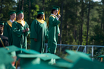 Second Place | Multiple PhotosSara Corce, The PilotGraduates walk across the stage to receive their diplomas during high school graduation at Pinecrest High School on Saturday, June 13, 2015 in Southern Pines, North Carolina.