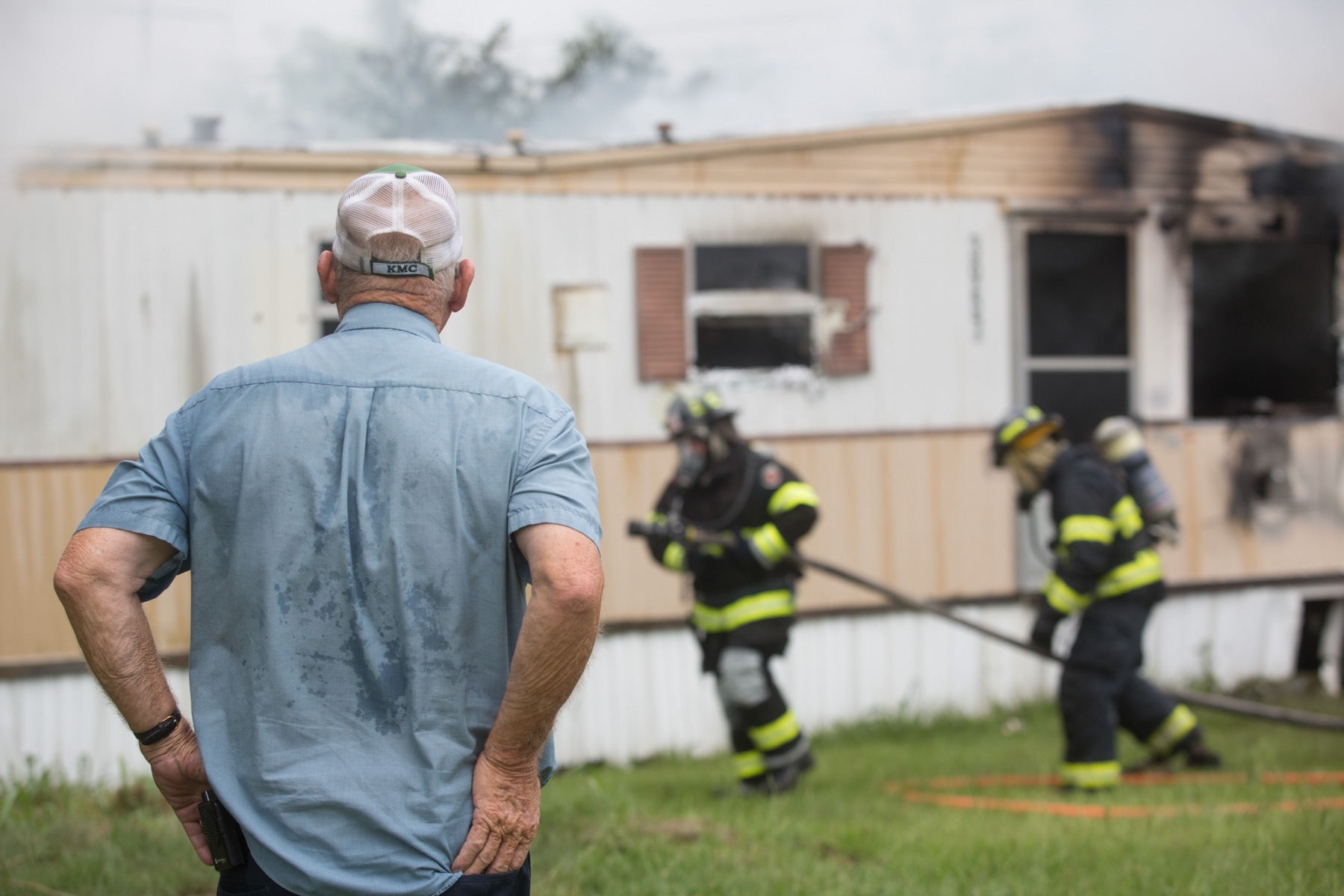 Third Place | Spot NewsJoe Pellegrino, The Daily ReflectorAn onlooker watches as firefighters respond to a fire at 3973 Lloyd Corey Road on Wednesday.