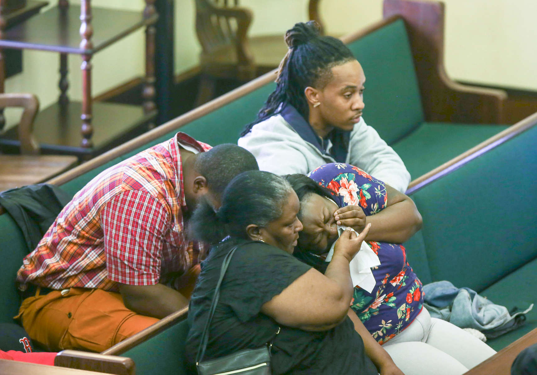 First Place | General NewsAileen Devlin, The Daily ReflectorJudges comments: Again, not deep in terms of number of entries but hard to place the top three. Strong graphic images with news content prevailed.Family members and friends of Anthony Antonio Johnson get emotional during the trial of Jahrheel Ikle May, 19, who is charged with murder in the death of Johnson, who was shot to death on January 2013 held at the Pitt County Courthouse on July 14, 2015.
