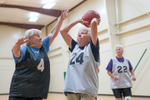 Third Place | SportsJoe Pellegrino, The Daily ReflectorMarilyn Holshouser tries to prevent Andrea Norris from shooting during a scrimage held by the Shooting 70's basketball team at JH Rose on June 30, 2015.