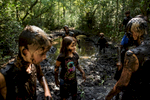 Second Place | Multiple PhotosAndrew Craft, The Fayetteville ObserverNatalie Schaffhauser, center, and her fellow campers get covered in mud during a mud walk Monday, July 20, 2015, at Camp Rockfish.