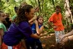 Second Place | Multiple PhotosAndrew Craft, The Fayetteville ObserverAJ Spry swings into the arms of his fellow campers during a group challenge Monday, July 20, 2015, at Camp Rockfish.