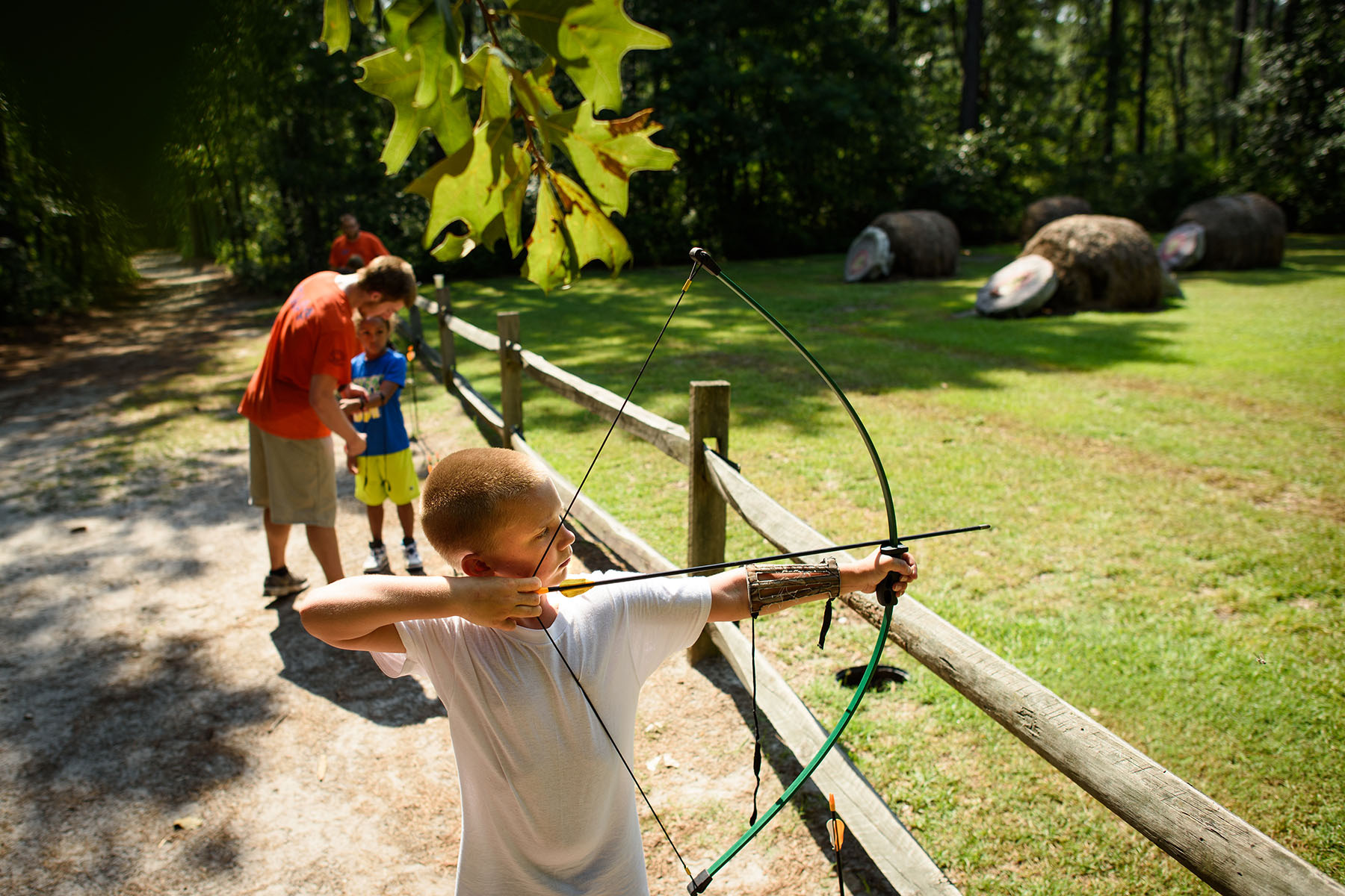 Second Place | Multiple PhotosAndrew Craft, The Fayetteville ObserverCamper Spencer Blay takes aim at his target during an archery activity Monday, July 20, 2015, at Camp Rockfish.