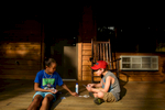 Second Place | Multiple PhotosAndrew Craft, The Fayetteville ObserverCampers, Jenna Lewis and Cooper Ogden play cards Monday, July 20, 2015, at Camp Rockfish.