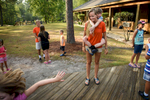 Second Place | Multiple PhotosAndrew Craft, The Fayetteville ObserverCamper Gehrum Crump hangs onto counselor Bri Cross' back as the day campers arrive Monday, July 20, 2015, at Camp Rockfish.