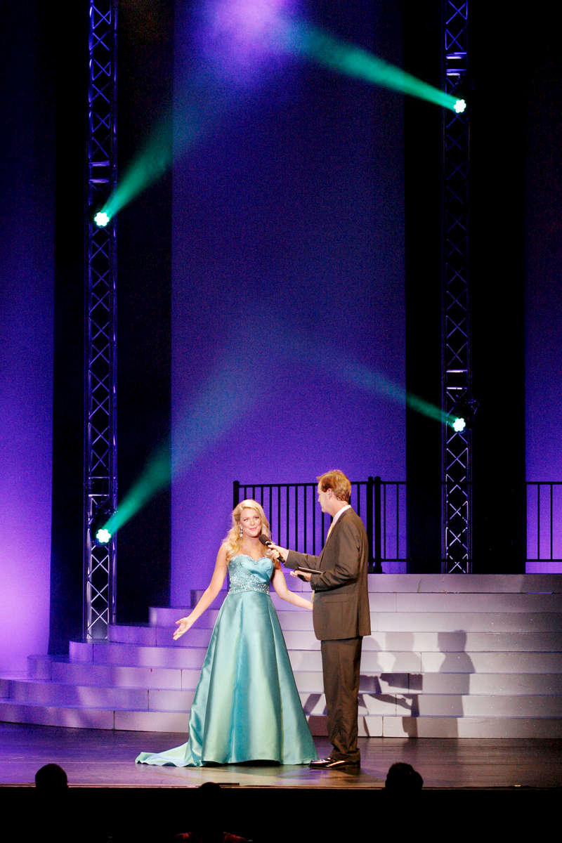 "Third Place | Multiple PhotosMark Dolejs, Daily DispatchEvan O'Geary, Miss Raleigh's Outstanding Teen, responds to the question from emcee Richard Green: What do you do for transportation since you are 17 and you don't drive? Her answer: ""My parents becuse they are awesome and they drive me everywhere."""