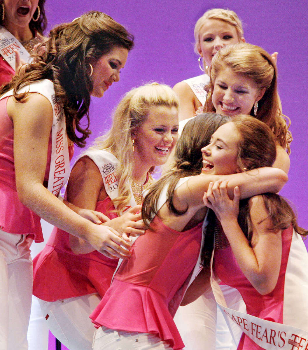 Third Place | Multiple PhotosMark Dolejs, Daily DispatchEvan O'Geary joins other contestants as they congratulate Catherine White, Miss Goldsboro's Outstanding Teen, after it was announced that she was one of the top 15 finalists. O'Geary did not finish as a finalist.