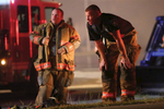 Third Place | Spot NewsCasey Mozingo, The Free PressChris Walker and Brian Davis catch their breath after fighting an 8-alarm fire inside Aycock Tractor Company Tuesday night. The red cross and several ambulances were on scene to treat firefighters if they were overheated or injured.