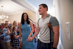 Second Place | General  NewsSara Corce, The PilotJonathan and Yulia Rivenbark walk through the front front door during their welcome home ceremony hosted by Helping a Hero at their new home in Legacy Lakes Resort on Tuesday, August 18, 2015 in Aberdeen, North Carolina.