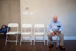Honorable Mention I FeatureSara Corce, The PilotJohn Jarrett sits as he waits for the ceremony to begin for retired Army Sergeant Jonathan Rivenbark and his wife Yulia at their new home in Legacy Lakes Resort on Tuesday, August 18, 2015 in Aberdeen, North Carolina.