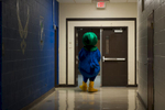 Honorable Mention I FeatureSara Corce, The PilotJim McDermott, dressed as Lewis the Duck, walks down the ball toward the gymnasium, at Pinecrest High School on Friday, August 7, 2015 in Southern Pines, North Carolina.