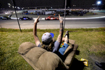 First Place | Multiple PhotosMykal McEldowney, The Greenville NewsDrew Porter cheers from a recliner as the renegade division heads around the track at Greenville-Pickens Speedway on Saturday, April 11, 2015. The backstretch of Greenville-Pickens Speedway's Historic Half Mile is a place where down-home relaxation and unbridled horsepower co-mingle every Saturday night. Where the deafening roar of the hopped-up stock cars provides a soothing soundtrack for those who crave speed, power, good food and good friends, and all at the same time. The three-level grass and dirt parking area that runs the length of the backstretch between State 124 and the speedway attracts a diverse group.