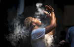 First Place | FeatureAndrew Dye, Winston-Salem JournalThomas Malcolm, of Jacksonville, vapes during VapeMania 15 at the Benton Convention Center on Friday, September 4, 2015 in Winston-Salem, N.C.