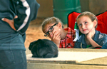 Third Place | FeatureKen Ruinard, Anderson Independent MailLila Morf (middle), 8, and Jaylie Gillespie, 7, (right) help judge {quote}Blue,{quote} a rabbit from teenager Jordan Sutter, during the County Livestock Show at the T. Ed Garrison Arena. The two children were able to join the judging panel for the high school competitor, after winning each of their divisions. {quote}Blue{quote} won both Best of Show and Best of Breed, and got a frozen banana treat from Sutter.