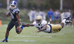 Second Place | SportsRob Brown, News & RecordDuke's Ryan Smith, left, eludes diving Georgia Tech defender Lawrence Austin during a 68-yard punt return during the first half of an NCAA football game, in Durham, N.C., Saturday, Sept. 26, 2015.