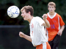 Third Place | SportsMark Dolejs, Daily DispatchKerr-Vance's Evan McGhee heads the ball in their game against Oxford Prep. The Spartans beat the Griffins 3-1 in their game Friday evening.