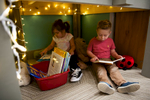 Second Place | Multiple PhotosSara Corce, The PilotKialee Lopez and Liam Lambert flip through books in a little reading nook at HOPE Academy, a recently opened pre-school, on Wednesday, September 16, 2015 in Robbins, North Carolina.